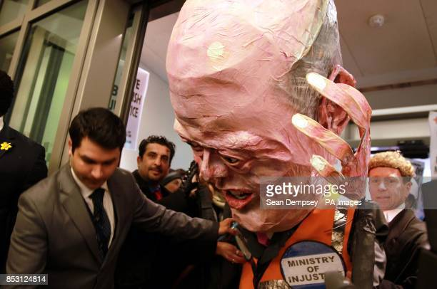 A protestor dressed as Justice Secretary Chris Grayling attempts to enter the Ministry of Justice in central London as lawyers from across the...