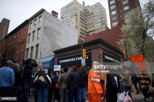 A protestor dressed as President Donald Trump demonstrates outside a Starbucks on April 15 2018 in Philadelphia Pennsylvania Police arrested two...