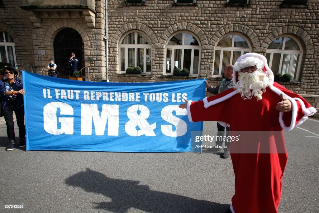 A Protestor Dressed As Santa Claus To Emphesize A Quote In June By The  French President In Which He Said He Said He Would Try His Best But He Was  U0027not Santa ...