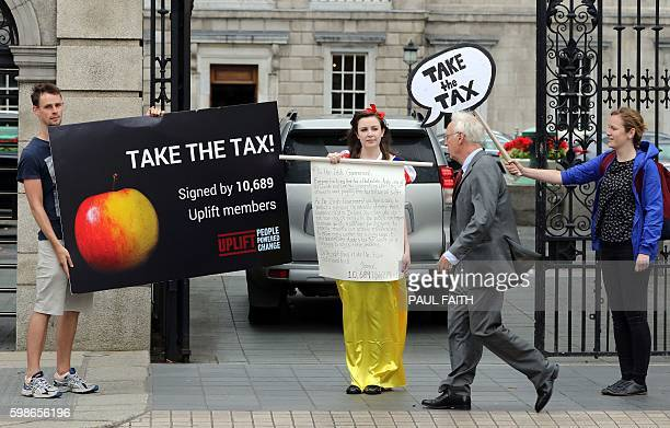 A protestor dressed as Snow White demonstrates outside the parliament buildings in Dublin in support of the EU ruling to take 13 billion euros in...