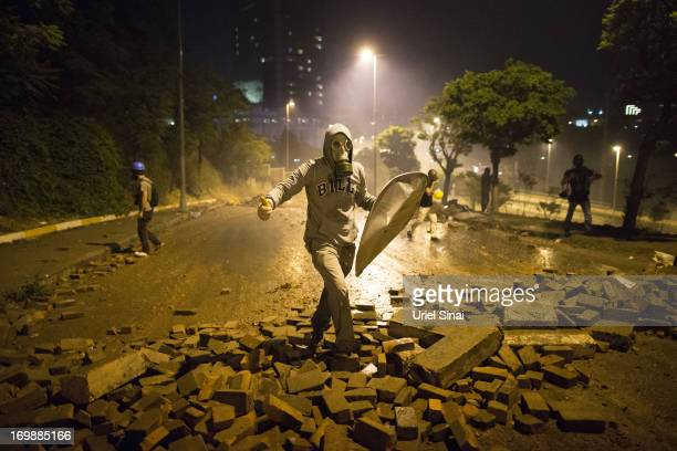 A protestor during clashes with Turkish police near Turkish prime minister Recep Tayyip Erdogan office between Taksim and Besiktas early morning on...