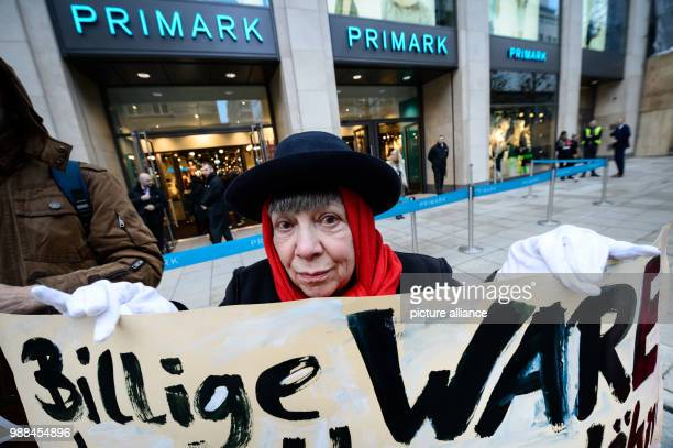 Protestor Esky Bail stands in front of the newly opened Primark shop with a sign reading CHEAP PRODUCE in Stuttgart Germany 5 December 2017 The...