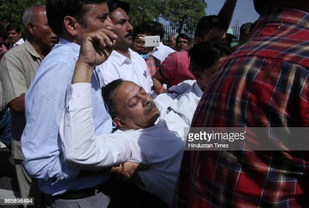A protestor falls unconscious during a rally by print and TV journalists against The Criminal Laws Ordinance on October 24 2017 in Jaipur India It...
