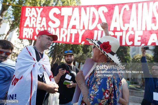 Protestor Fred Dodsworth right argues with a man who is a President Donald Trump supporter left during the No to Marxism in America rally in Martin...