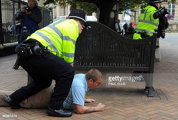 A protestor from the English Defence League is arrested by police after clashes with antiracists during a demonstration against Islamic extremism in...
