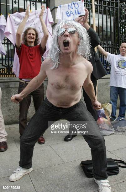 A protestor from the take the shirt off my back lobby group from Fermoy Co Cork outside Leinster House Dublin as TD's return to the Dail after the...