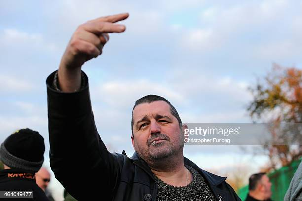 A protestor gestures as antifracking protestors try to stop trucks carrying chemicals to the Barton Moss gas fracking facility on January 20 2014 in...