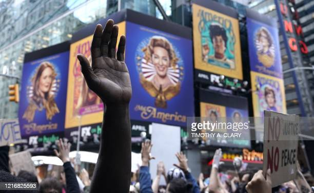A protestor hands is seen above the crowd in Times Square on June 1 during a Black Lives Matter protest New York's mayor Bill de Blasio today...