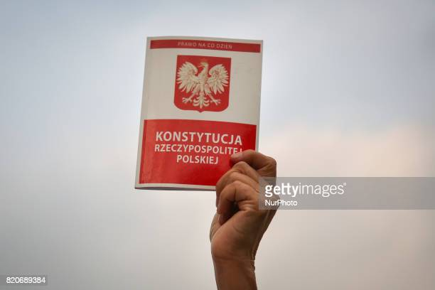 A protestor hold a copy of Polish Constitution outside the Regional Court during ' Chain of Light ' during another day of protests against government...