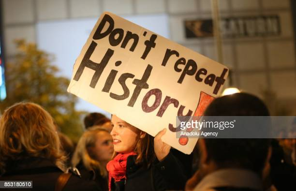 A protestor holds a banner reading 'Don't Repeat History' during a demonstration against the rightwing party Alternative fuer Deutschland in Berlin...