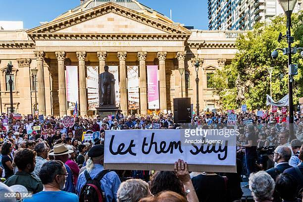 A protestor holds a banner reading Let Them Stay during a rally organised after the Australian High Court had rejected a challenge to the...