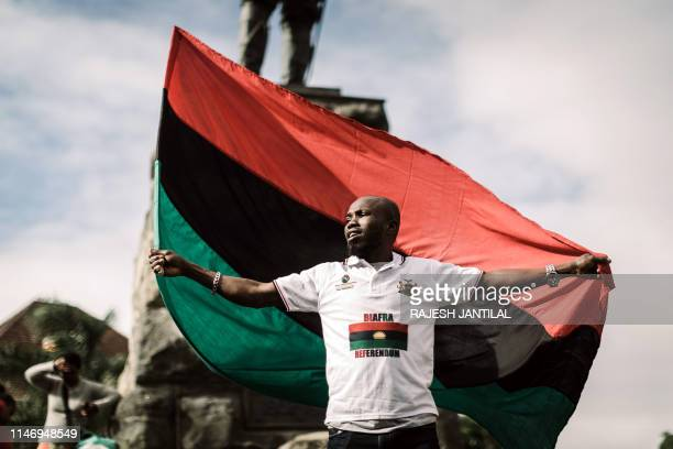 A protestor holds a Biafra flag as he takes part in a demonstration in Durban South Africa on May 30 2019 during a Freedom March for Biafra held...