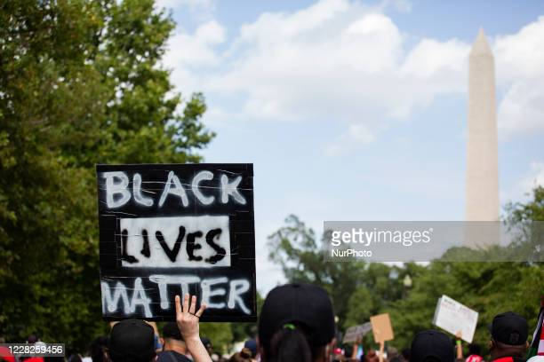 Protestor holds a Black Lives Matter sign during the 57th annual March on Washington, Friday, August 28, 2020 in Washington, D.C. , Maryland. Also...
