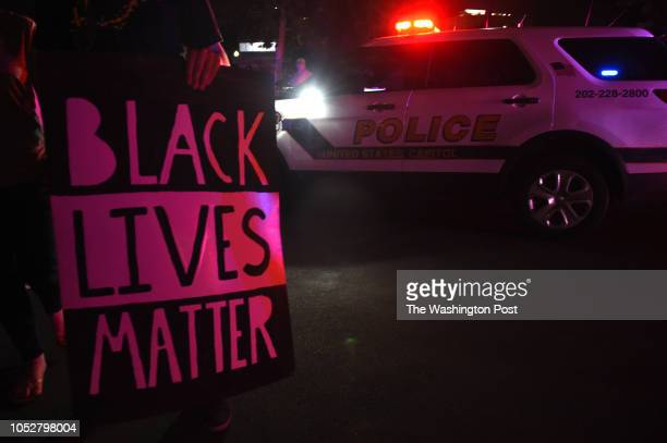 A protestor holds a Black Lives Matter sign outside of the US Capitol building Thursday July 7 2016 in Washington DC The demonstration was held in...