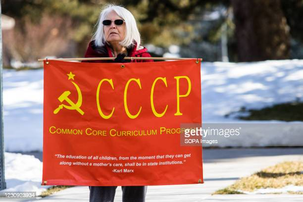 Protestor holds a CCCP placard during the demonstration. Protesters gathered at the state's legislative building to protest various causes such as...
