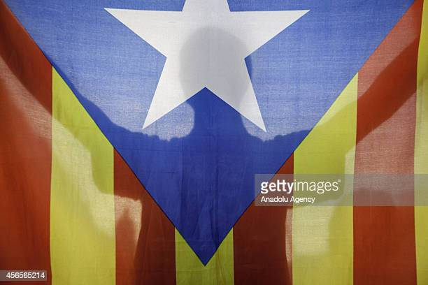A protestor holds a Estelada the Catalan independentist flag as Students for 9N a platform of several students organizations protest to demand of the...