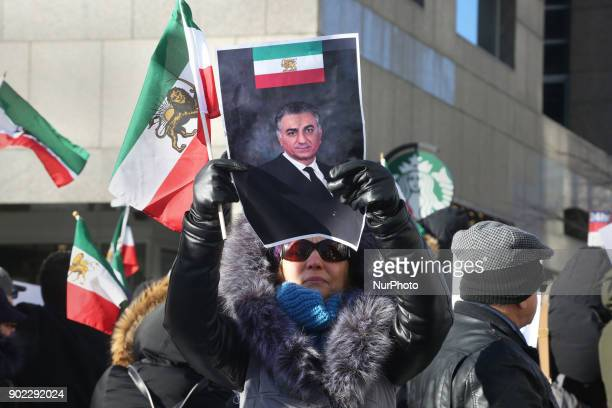 Protestor holds a photo of Reza Pahlavi as hundreds of Canadians take part in a protest against the Islamic Republic of Iran in Toronto Ontario...