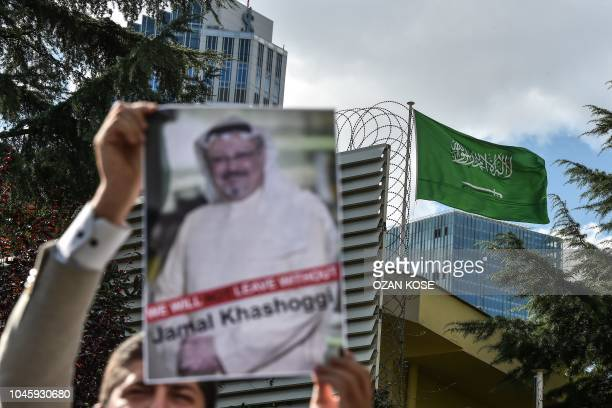 A protestor holds a picture of missing journalist Jamal Khashoggi during a demonstration in front of the Saudi Arabian consulate on October 5 2018 in...