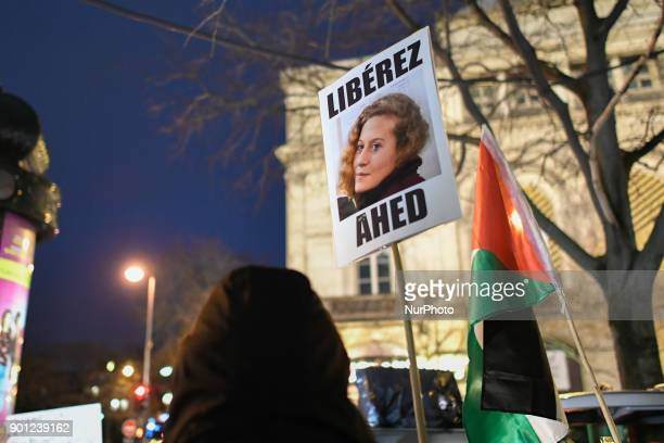 A protestor holds a placard bearing the portrait of Palestinian teenager Ahed Tamimi during a demonstration in her support on January 4 in Paris...