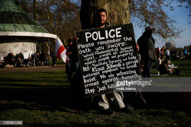 """Protestor holds a placard during a """"Unite For Freedom"""" anti-lockdown demonstration held to protest against the use of vaccine passports in the United..."""