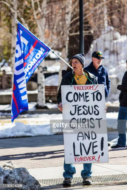 Protestor holds a placard during the demonstration. Protesters gathered at the state's legislative building to protest various causes such as the...