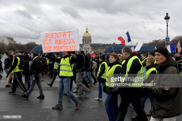 A protestor holds a placard reading Bye bye mafia people during an antigovernment demonstration called by the Yellow Vests Gilets Jaunes movement...