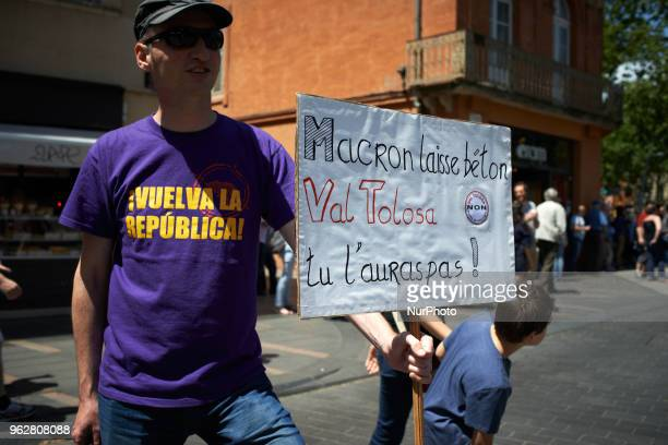 A protestor holds a placard reading 'Macron Drop it You wouldn't have Val Tolosa' Val Tolosa is a place near Toulouse where UnibailRodamco plans to...