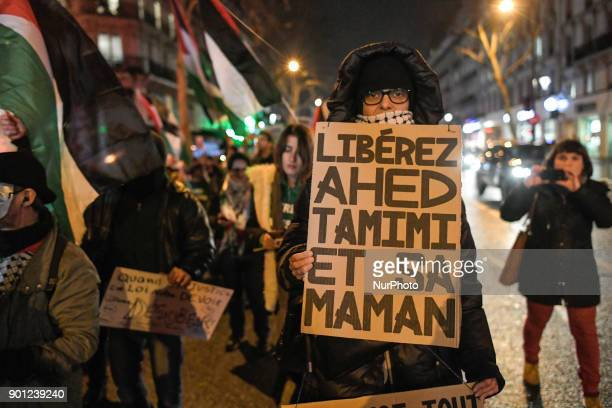 A protestor holds a placard reading quotFree Ahed Tamimi and her mumquot during a demonstration in her support on January 4 in Paris Israel charged a...