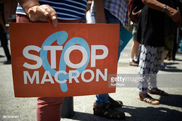 A protestor holds a placard reading 'Stop Macron' A quotmaree populairequot demonstration was called by more than 60 political organisations...