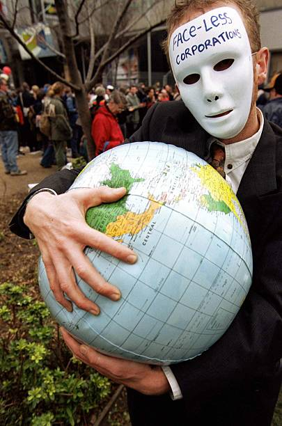 A protestor holds a plastic ball with a world map pictures getty a protestor holds a plastic ball with a world map gumiabroncs Images