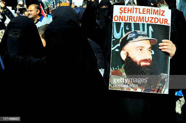Protestor holds a poster of Chechen leader Char Dudayev near the Russian consulate during a demonstration in Istanbul, on September 24, 2011. Three...