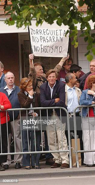 Protestor holds a sign against Jorge Zorreguieta, the father of Princess Maxima of the Netherlands at the Christening of baby girl Catharina-Amalia,...