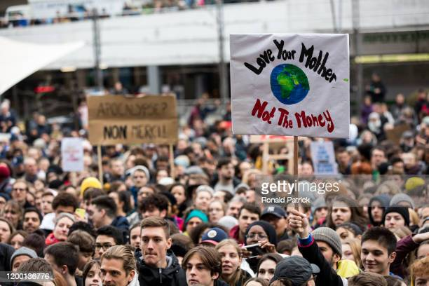 A protestor holds a sign at a demonstration against climate change where climate activist Greta Thunberg addressed a multitudinary crowd on January...