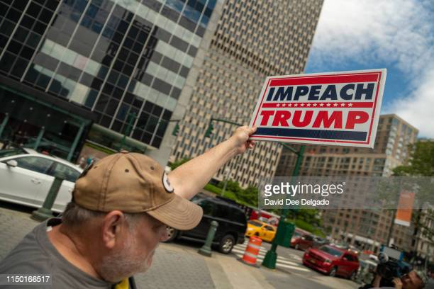 A protestor holds a sign calling for the impeachment of US President Donald Trump during a demonstration on June 15 2019 in New York City Major...