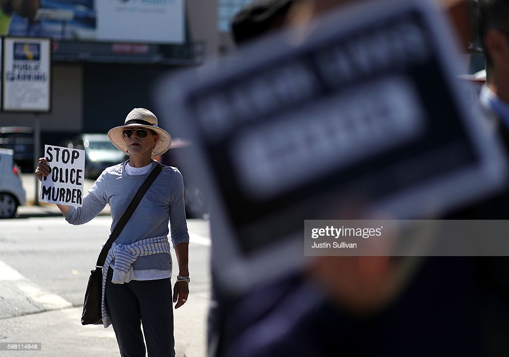 A protestor holds a sign during a demonstration in support of San Francisco 49ers quarterback Colin Kaepernick outside of the San Francisco Police Officers Association offices on August 31, 2016 in San Francisco, California. Kaepernick has come under fire for refusing to stand during the Star Spangled Banner in protest of what he complains is oppression of blacks and other peoples of color. The San Francisco Police Officers Association has written a letter to the NFL and San Francisco 49ers asking for an apology from Kaepernick for comments he made about police officer training.