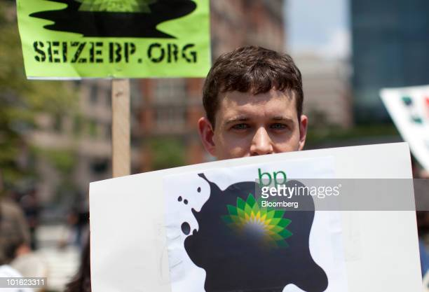 A protestor holds an antiBP Plc sign during a demonstration outside of BP's government affairs office in Washington DC US on Friday June 4 2010...