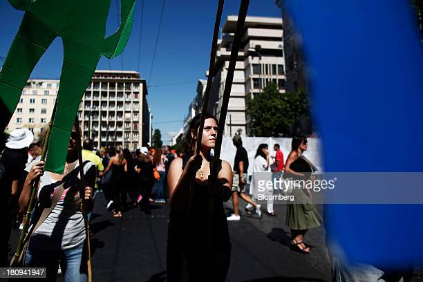 A protestor holds an effigy during a demonstration to mark the start of a 48hour strike by Greece's biggest publicsector union ADEDY in central...