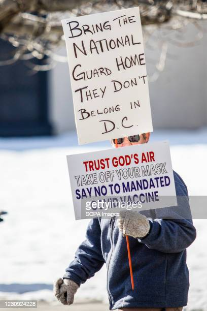 Protestor holds placards during the demonstration. Protesters gathered at the state's legislative building to protest various causes such as the...