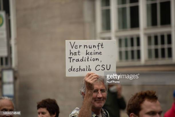 Protestor holds sign saying 'Reason has no tradition so vote CSU' Several ten thousands people demonstrated in Munich Germany on 22 July 2018 against...