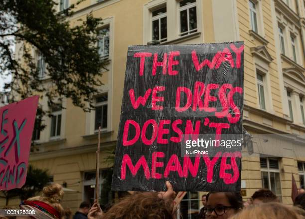 Protestor holds sign saying 'The way we dress doesn't mean yes' Some 500 people demonstrated through the streets of Munich Germany on 21 July 2018 to...