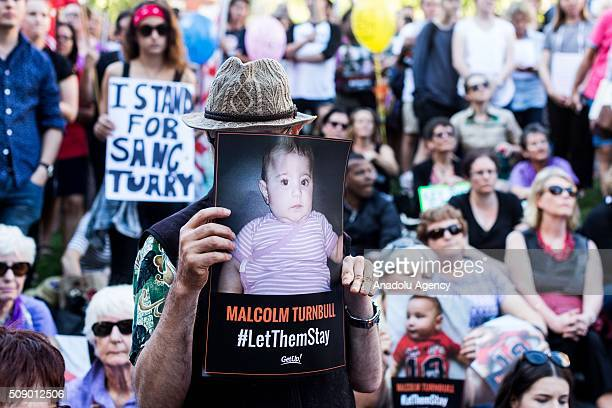 A protestor holds up a placard of a baby asking Malcolm Turnbull to let them stay during a rally organised after the Australian High Court had...