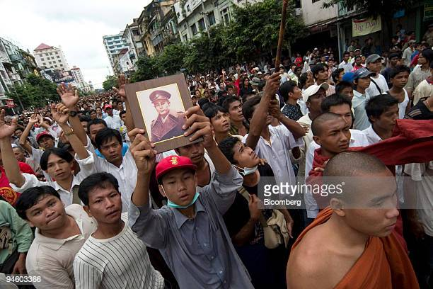 Protestor holds up a portrait of General Aung San during a demonstration in downtown Yangon, formerly known as Rangoon, in Myanmar, on Thursday,...