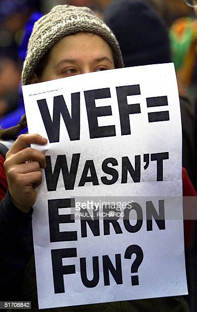 A protestor in Manhattan holds a sign in front of the building housing the Enron accounting firm of Arthur Andersen 04 February 2002 as the World...