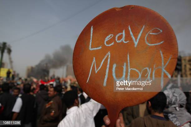 A protestor in Tahrir Square holds up a sign calling on President Mubarak to leave on January 29 2011 in Cairo Egypt Tens of thousands of...
