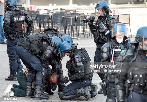 """Protestor is arrested by French gendarmes during an anti-government demonstration called by the """"Yellow Vests"""" movement in Nantes, Western France on..."""