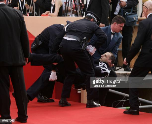 """Protestor is been removed by the gendarmes from the red carpet during """"The Da Vinci Code"""" World Premiere & Opening Gala at the Palais during the 59th..."""