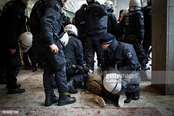 A protestor is being arrested by the police in Hannover Germany on 17 March 2017 during the Kurd's protest against the turkish military offensive in...