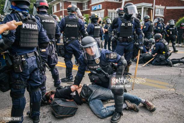Protestor is detained following the grand jury verdict on September 23, 2020 in Louisville, Kentucky. Protesters marched in the streets after a...