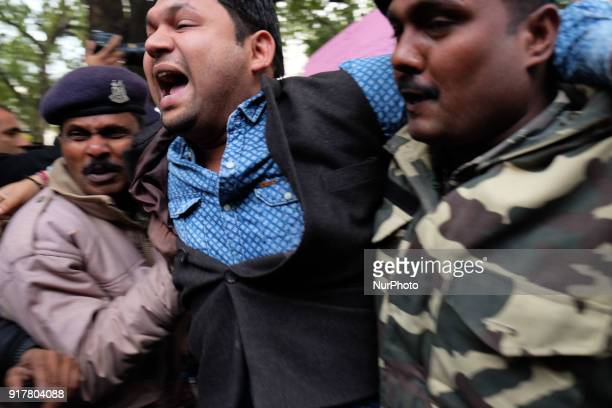 Protestor is dragged by Delhi police officials into a bus as Indian Youth Congress staged a protest demanding an apology for what it termed as...