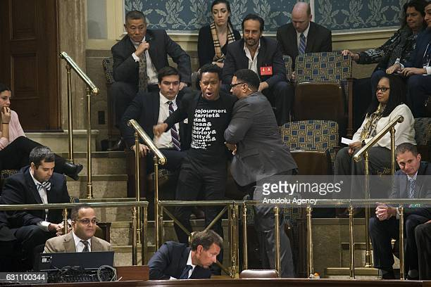 A protestor is escorted out of the House gallery by a Capitol Police officer after interrupting the joint session of Congress accepting the Electoral...